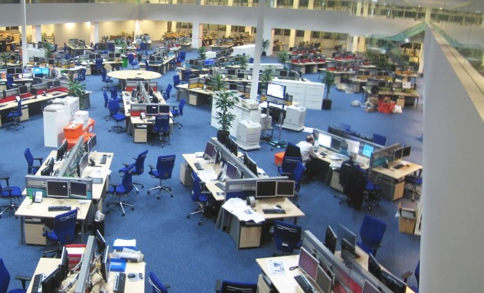 """Newsroom panorama"" by David sim, licence: CC BY 2.0, cropped"