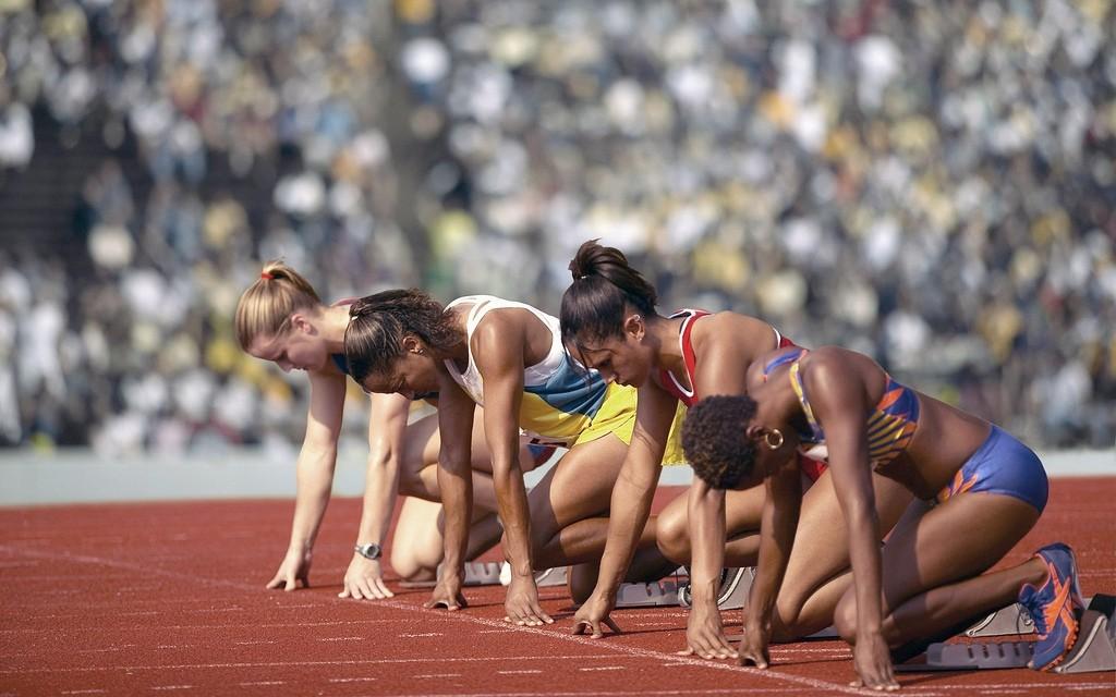 Female Track Athletes at Starting Line