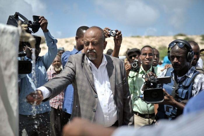 A Mogadishu offiicial tastes the water at a new well donated by the African Union Mission in Somalia in front of local journalists in the country's capital on June 6. AMISOM Photo / Tobin Jones