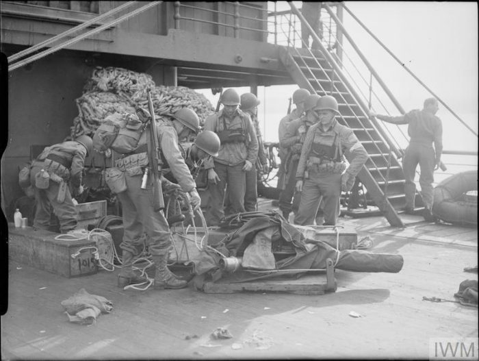 """Picture: """"American troops preparing to unload materials for shore"""" by © IWM (A 12683), IWM non-commercial licence"""