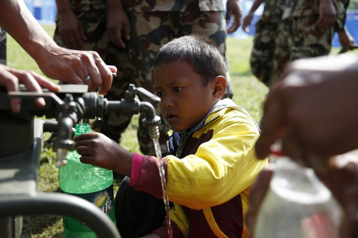 Gurkha engineers construct a water purification system for people living in a camp in Kathmandu following earthquake by DFID - UK Department for International Development, licence: CC BY 2.0