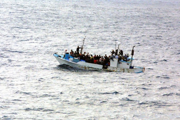 Refugees on a boat, photograph courtesy of U.S. Navy, licence CC0 1.0