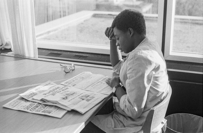 Young woman reading newspaper at Ohio Univeristy, 1980, photo courtesy of Ohio University Libraries, licence CC BY-NC-ND 2.0