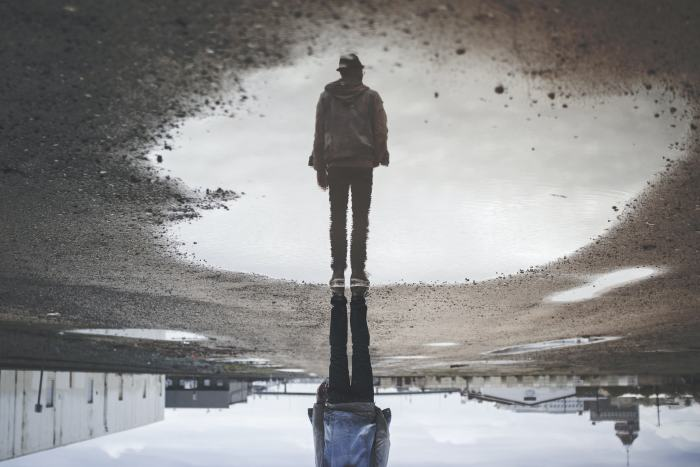 Picture: man's reflection on body of water, by Randy Jacob, license Unsplash