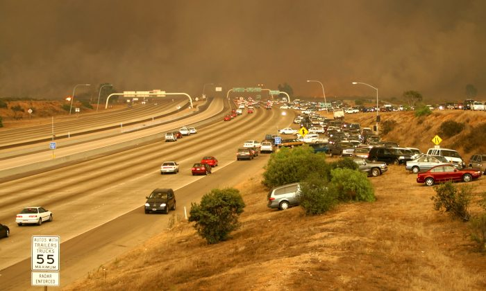 Picture: Cedar Fire crosses Interstate 15, October 2003, by United States Marine Corps, Wikimedia Commons